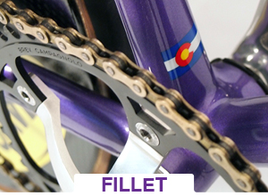 purple fillet bicycle close up of sprocket and weld intersection