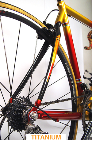 titanium bicycle with yellow and red paint